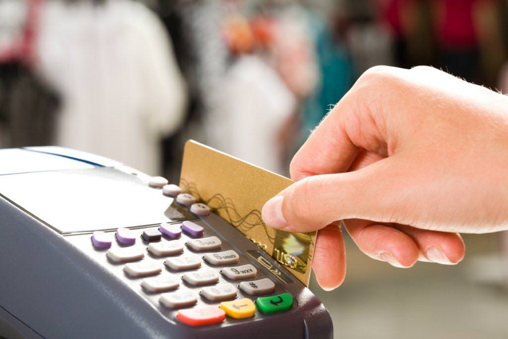 Employee processing a credit card transaction in a retail store